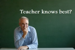male teacher at blackboard